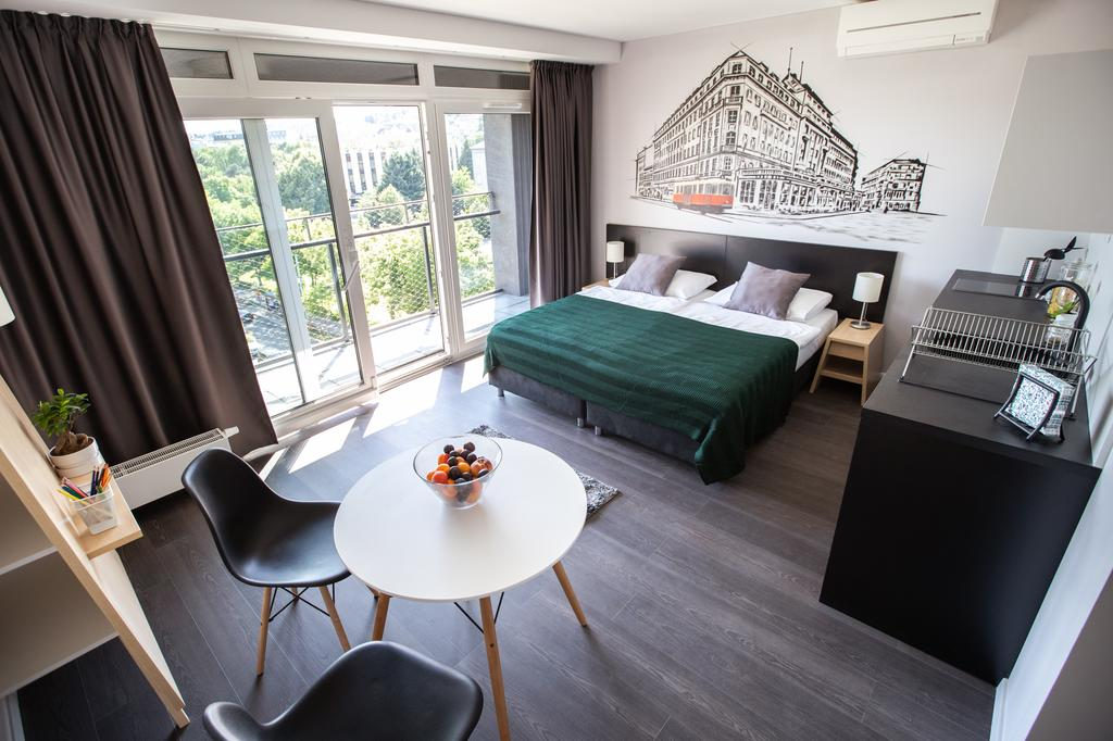 Studio apartment Bratislava - sleeping and dining areas