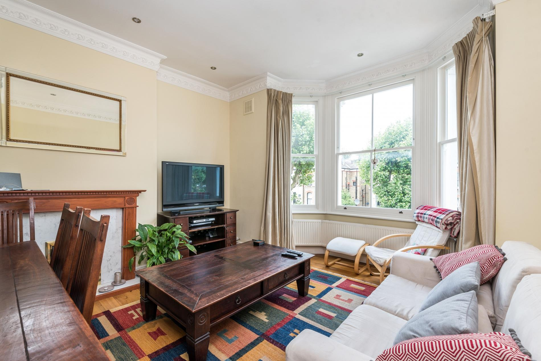 Two bedroom home London - living area - widescreen TV - wooden furniture