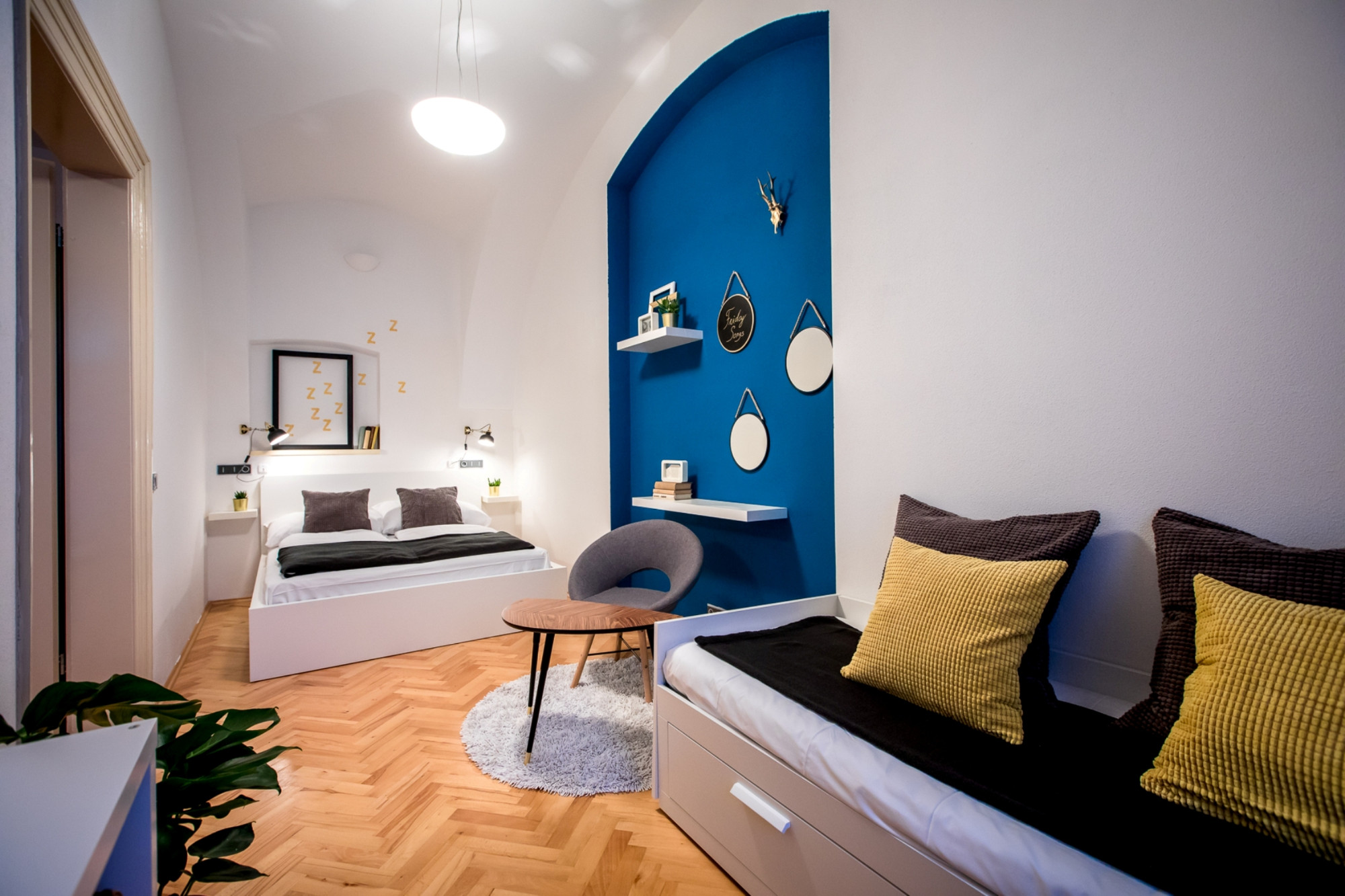 bedroom in blue apartment near prague castle