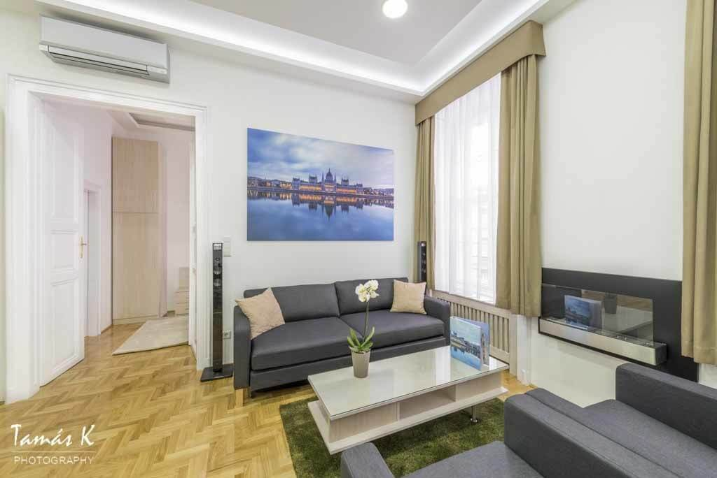 Serviced apartment Budapest - living area - large sofa bed - coffee table